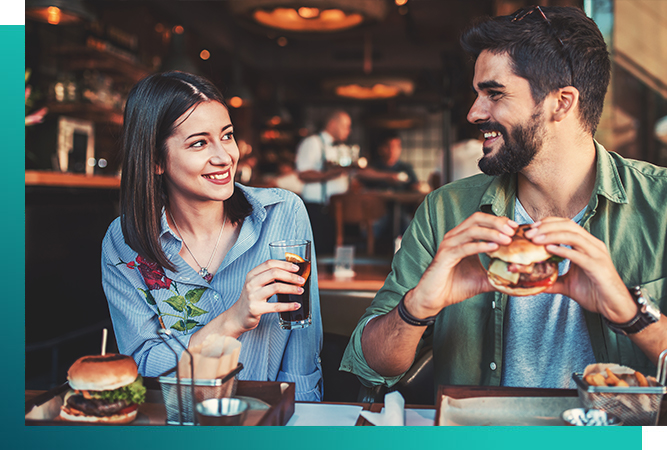 Couple having burgers. both laughing